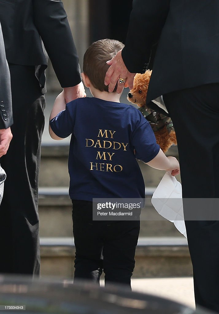 2yearold Jack Rigby arrives for the funeral service of his father Fusilier Lee Rigby at Bury Parish Church on July 12 2013 in Bury Greater Manchester...