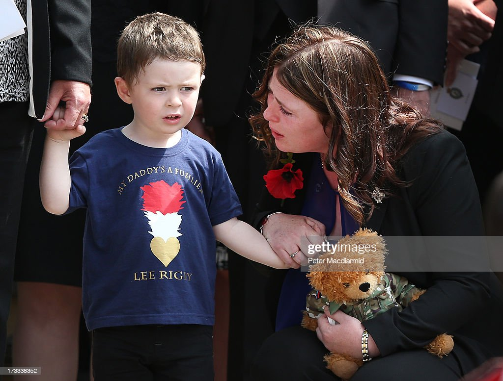 2yearold Jack Rigby is comforted by his mother Rebecca as the coffin of his father Fusilier Lee Rigby leaves Bury Parish Church after a military...