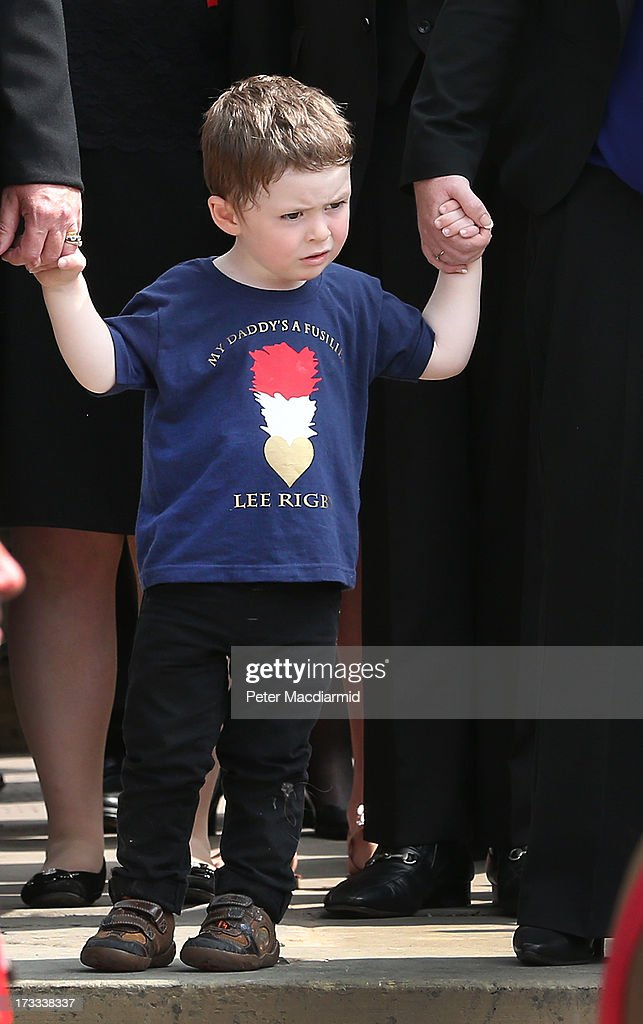 2yearold Jack Rigby watches as the coffin of his father Fusilier Lee Rigby leave Bury Parish Church after his military funeral on July 12 2013 in...