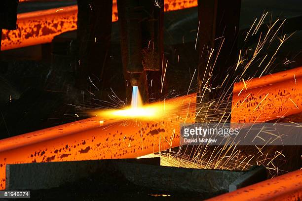 3000degree steel billets are cut to size as 12153 illegal guns and other weapons confiscated from criminals are melted to be converted into steel...