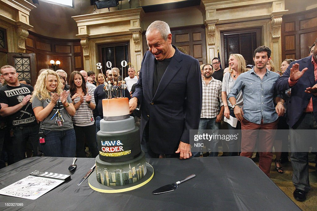 UNIT -- 300th Episode Celebration -- Pictured: Executive Producer <a gi-track='captionPersonalityLinkClicked' href=/galleries/search?phrase=Dick+Wolf&family=editorial&specificpeople=210651 ng-click='$event.stopPropagation()'>Dick Wolf</a> cuts into a cake to celebrate the 300th episode of 'Law & Order: Special Victims Unit' --