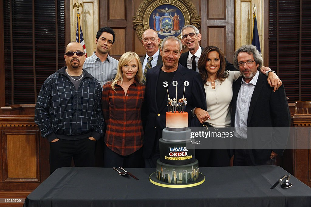 UNIT -- 300th Episode Celebration -- Pictured: (l-r) <a gi-track='captionPersonalityLinkClicked' href=/galleries/search?phrase=Ice-T&family=editorial&specificpeople=213017 ng-click='$event.stopPropagation()'>Ice-T</a> as Detective Odafin 'Fin' Tutuola, <a gi-track='captionPersonalityLinkClicked' href=/galleries/search?phrase=Danny+Pino&family=editorial&specificpeople=240258 ng-click='$event.stopPropagation()'>Danny Pino</a> as Detective Nick Amaro, <a gi-track='captionPersonalityLinkClicked' href=/galleries/search?phrase=Kelli+Giddish&family=editorial&specificpeople=2159135 ng-click='$event.stopPropagation()'>Kelli Giddish</a> as Detective Amanda Rollins, <a gi-track='captionPersonalityLinkClicked' href=/galleries/search?phrase=Dann+Florek&family=editorial&specificpeople=842370 ng-click='$event.stopPropagation()'>Dann Florek</a> as Captain Donald Cragen, Executive Producer Dick Wolf, <a gi-track='captionPersonalityLinkClicked' href=/galleries/search?phrase=Richard+Belzer&family=editorial&specificpeople=206227 ng-click='$event.stopPropagation()'>Richard Belzer</a> as Detective John Munch, <a gi-track='captionPersonalityLinkClicked' href=/galleries/search?phrase=Mariska+Hargitay&family=editorial&specificpeople=204727 ng-click='$event.stopPropagation()'>Mariska Hargitay</a> as Detective Olivia Benson, Executive Producer Warren Leight --