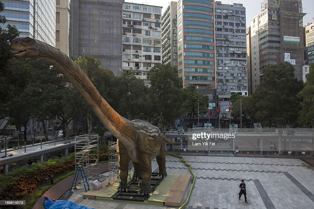 A 30-metre-long and 10-metre-high Daxiatitan binglingi robotic dinosaur stands in Hong Kong Science Museum on October 25, 2013 in Hong Kong, Hong Kong. Hong Kong Science Museum has started to set up the exhibits for its upcoming large-scale 'Legends of the Giant Dinosaurs' exhibition. Among the exhibits will be six large robotic dinosaurs specially produced for the exhibition and set to be installed this Friday October 25. These six robotic dinosaurs will be put on display in the piazzas of the museum.