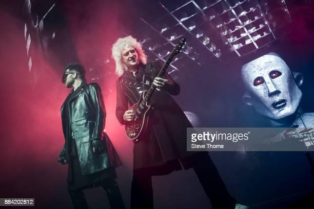 Adam Lambert Brian May and Roger Taylor perform at Arena Birmingham on November 30 2017 in Birmingham England