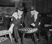 Mr A Dowling and Mr J F Blake indulge in a game of chess on the chess table which won first prize in the Annual London Telephone Region Hobbies...