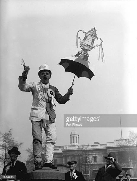 An enthusiastic Everton fan celebrates his team's victory against Manchester City in the FA Cup Final by waving a customised umbrella in London's...