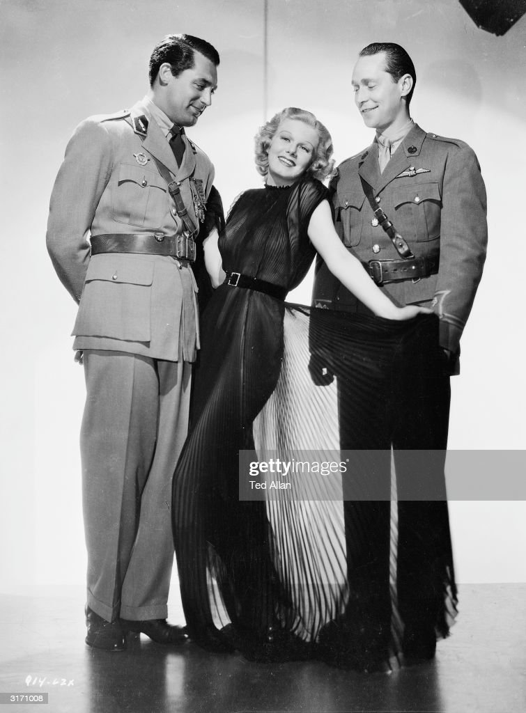 Actors Jean Harlow, Cary Grant (1904 - 1986) and Franchot Tone, stars of the film 'Suzy', directed by George Fitzmaurice for MGM.
