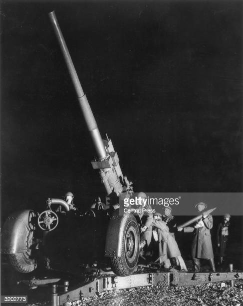 Soldiers loading a 37 antiaircraft gun during a night exercise