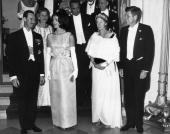 US president John F Kennedy and Jacqueline Kennedy pose with the Grand Duchess Charlotte of Luxembourg during a State Dinner in her honor at the...