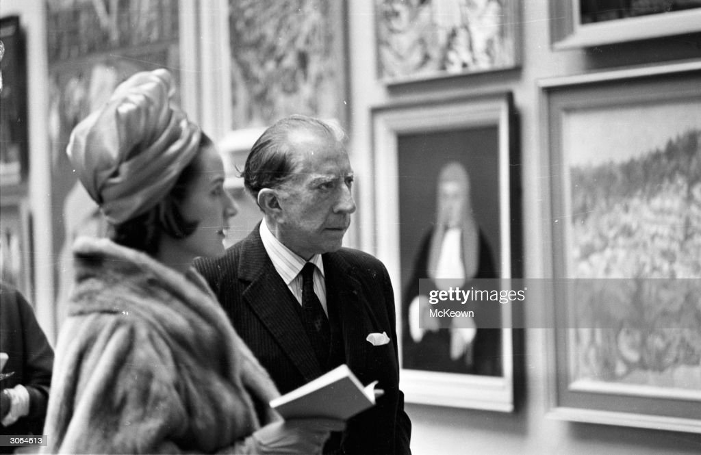 American oil executive, multi-millionaire and art collector John Paul Getty (1892 - 1976) attends a private viewing of the Royal Academy Summer Exhibition in London, with his secretary Robina Lund.