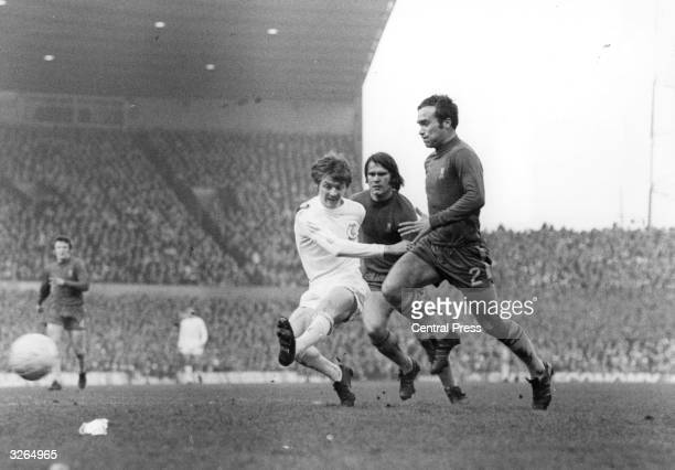Alan Clarke of Leeds United takes a shot at the Chelsea goal as Chelsea defenders Ron Harris and Dave Webb approach during the FA Cup Final replay at...