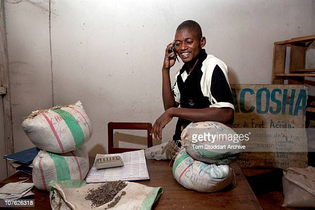 Picture shows dealer Jean Pierre Shungu at work in his Bukavu warehouse He sells the coltan and cassiterite ore onto international markets for use by...