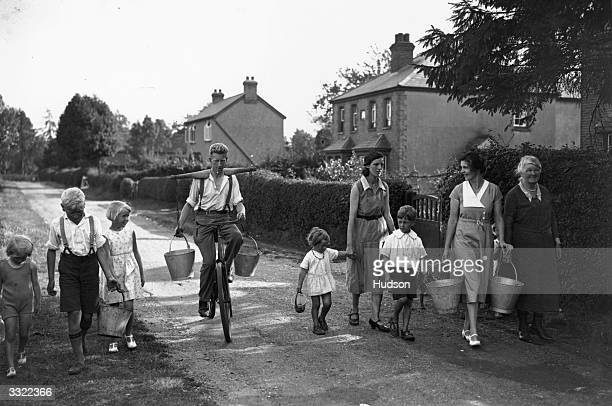 Villagers from Holmer Green near High Wycombe Buckinghamshire carrying buckets in search of water The area is experiencing a drought following a...