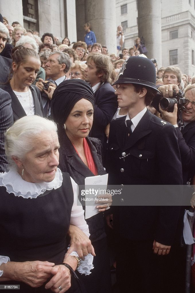British born American actress Elizabeth Taylor at the memorial service for her ex-husband, Richard Burton at the church of St Martin-in-the-Fields, London, with his elderly sister.