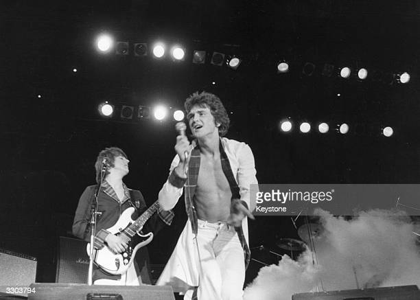 Singer Les McKeown with Scottish pop group The Bay City Rollers playing at the Budokan in Tokyo where young girls fainted with excitement and had to...