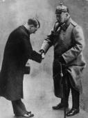 Soldier and statesman President Paul von Beneckendorff und von Hindenburg handing over the rule of Germany to the Nazi leader Adolf Hitler