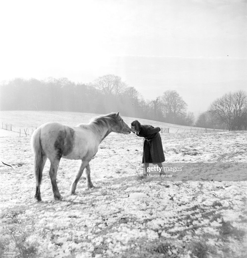 Animal trainer Barbara Woodhouse (1910 - 1988) making friends with a pony in Hertfordshire. Original Publication: Picture Post - 6889 - The Woman Who Talks To Animals - pub. 1954