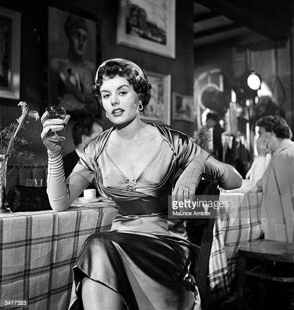 British actress Eunice Gayson enjoying a glass of wine on the set of 'Dance Little Lady' Original Publication Picture Post 6885 January Personality...