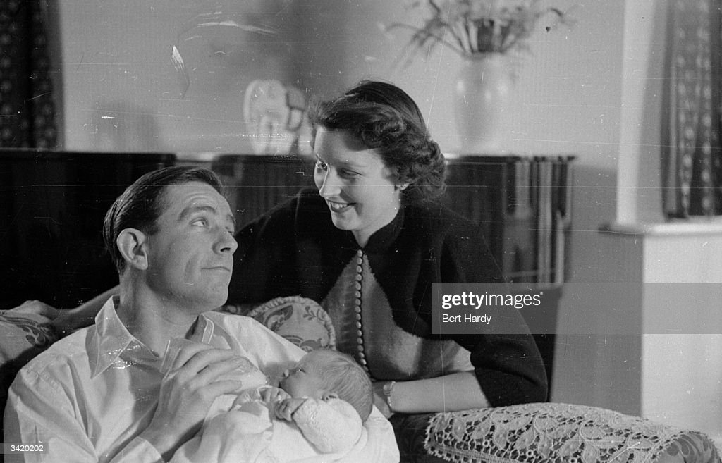 British comic actor Norman Wisdom, at home with wife Freda and son Nicholas. Original Publication: Picture Post - 6887 - Will Norman Wisdom Be Another Charlie Chaplin? - pub.1954