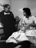 Moyra Fraser star of 'Airs on a Shoestring' has a beauty treatment at one of the salons of Polishborn US beautican and business executive Helena...