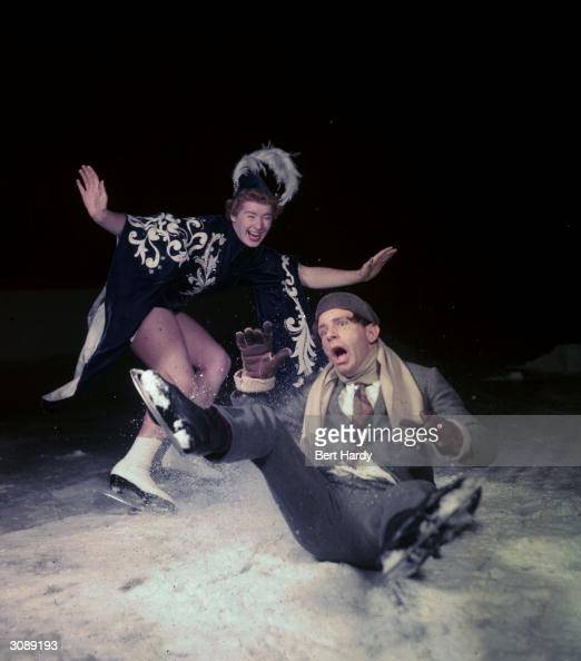 Popular English comedian Norman Wisdom performs a pratfall in the pantomime 'Sinbad the Sailor on Ice' at the Empress Hall London Original...