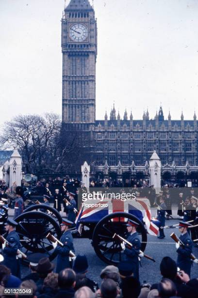 A gun carriage carrying the coffin of Winston Churchill passes Big Ben clock tower from Westminster Hall through London to St Paul's Cathedral during...