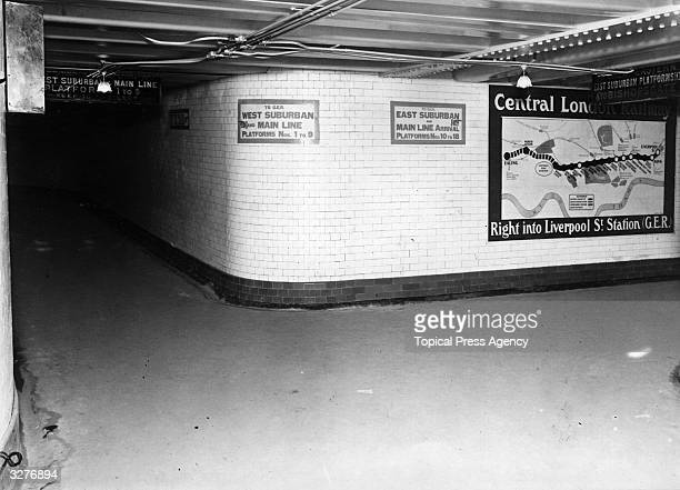 A poster showing the extension of the Central Line on the London Underground to Ealing at Liverpool Street Station