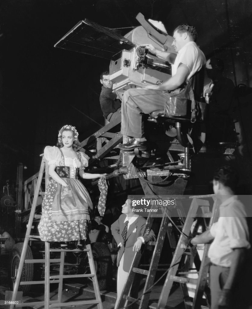 Writer and director Dorothy Arzner (1897 - 1979), famous for her masculine attire, directs Joan Crawford in a scene from the movie 'The Bride Wore Red'. Arzner worked in Hollywood at a time when female directors were a rare commodity.
