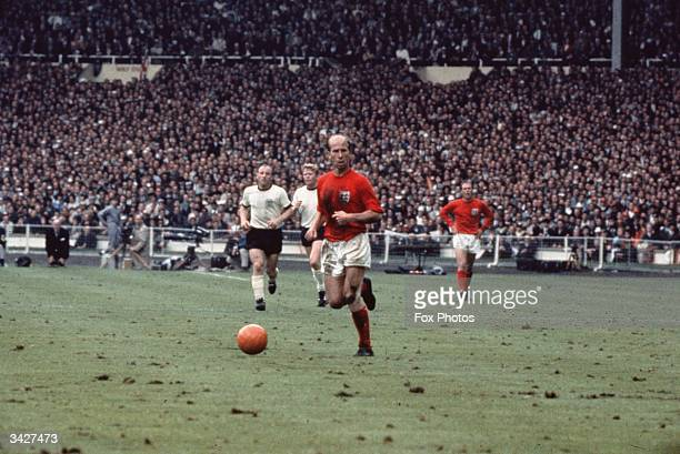 Bobby Charlton with the ball during the 1966 World Cup Final against West Germany at Wembley Stadium England won 42