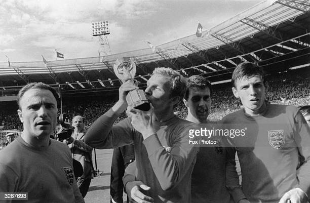 Bobby Moore England captain kisses the Jules Rimet World Cup trophy after England's 42 win over West Germany in the World Cup final at Wembley...
