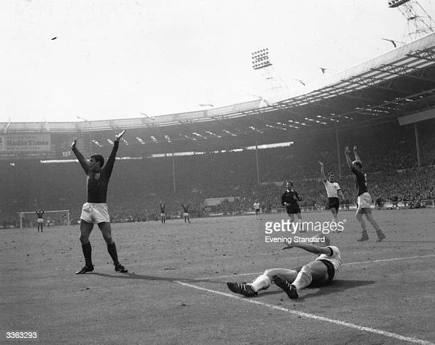 Geoff Hurst scores a goal for England during the World Cup Final match against West Germany at Wembley Stadium London