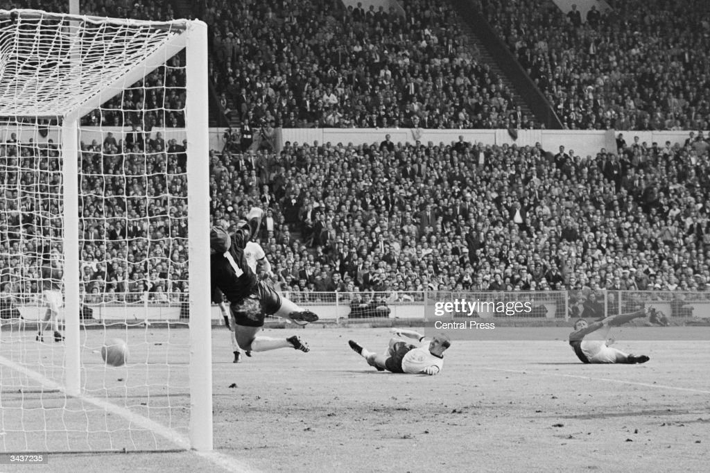 Geoff Hurst scores a third goal for England during the World Cup Final match against West Germany at Wembley Stadium. The ball hit the crossbar and rebounded downwards, but a goal was declared by the referee, allowing England to win 4-2.