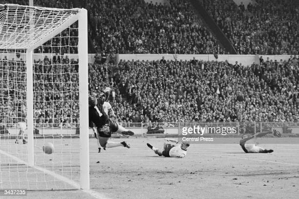 Geoff Hurst scores a third goal for England during the World Cup Final match against West Germany at Wembley Stadium The ball hit the crossbar and...