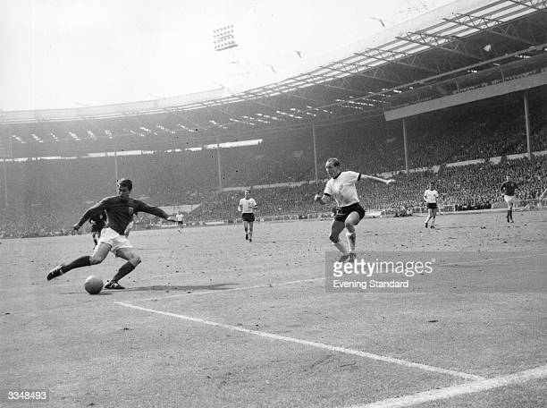 Geoff Hurst scoring England's first goal during their World Cup Final match against West Germany at Wembley Stadium England went on to win 42