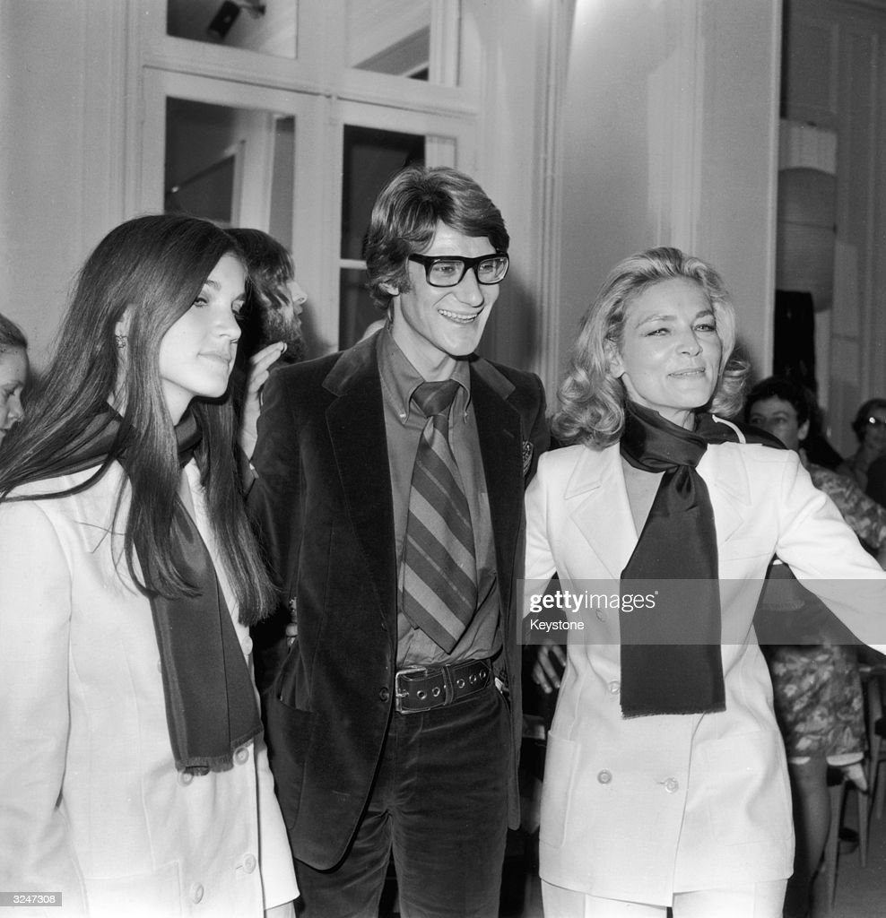 French designer Yves Saint-Laurent poses with American actress Lauren Bacall and her daughter Leslie, at a showing of his latest collection in Paris.