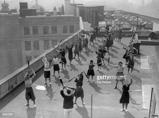 Women from the BBC's Bush House in the Strand London have physical training exercise classes on the rooftop