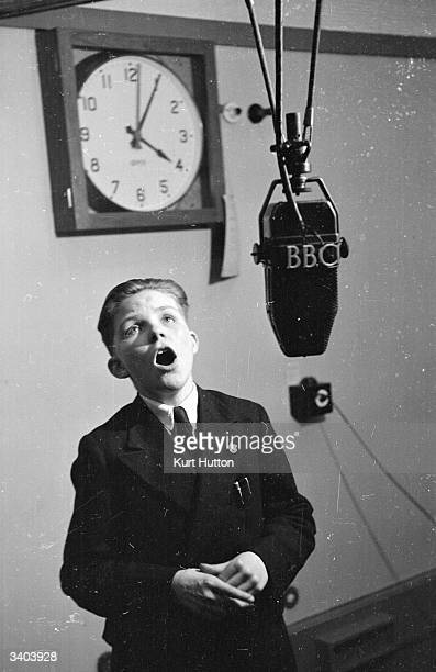 Child singer Gerald Rogan sings for BBC Radio's 'Children's Hour' Original Publication Picture Post 4019 Children's Hour pub 1946