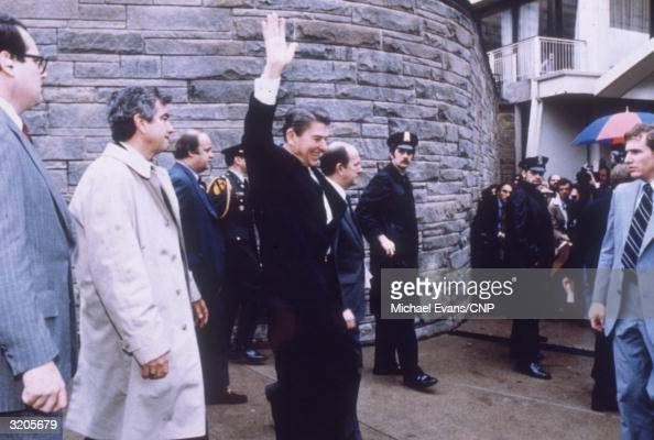 President Ronald Reagan waves to the crowd shortly before the assassination attempt which took place outside the Hilton Hotel in Washington