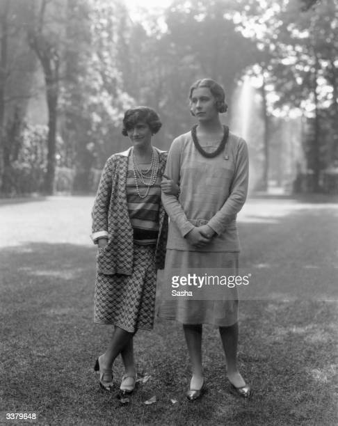 French couturier Coco Chanel left with Lady Abdy in the garden of Chanel's Faubourg St Honore home Paris