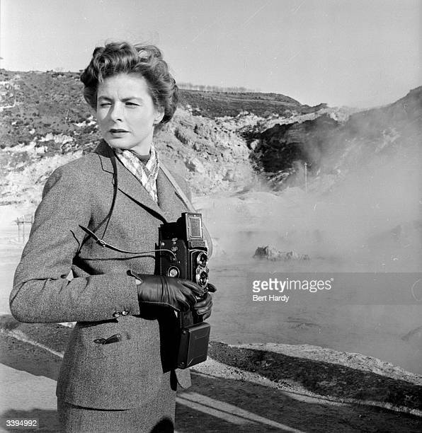 Swedish actress Ingrid Bergman taking a photograph in a break from filming 'Visit To Italy' in Naples Original Publication Picture Post 6514 Ingrid...