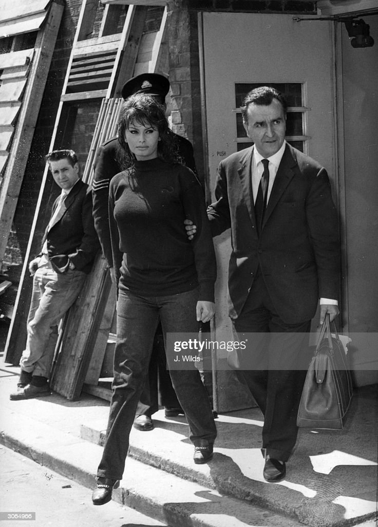 Italian actress Sophia Loren with the French film producer Pierre Rouve at Elstree Studios during the filming of 'The Millionairess' after jewels worth £180,000 were stolen from her home.