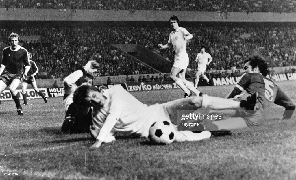Alan Clarke of Leeds United is tackled by Franz Beckenbauer of Bayern Munich during the European Cup Final in Paris