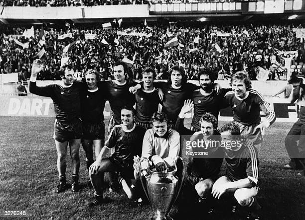 The Bayern Munich football side with the European cup after beating Leeds United 20 in Paris