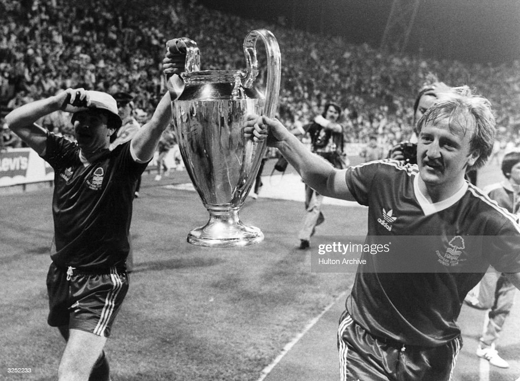 The victorious players of Nottingham Forest carry the European Cup trophy on a lap of honour after their 10 victory over the Swedish side Malmo in...