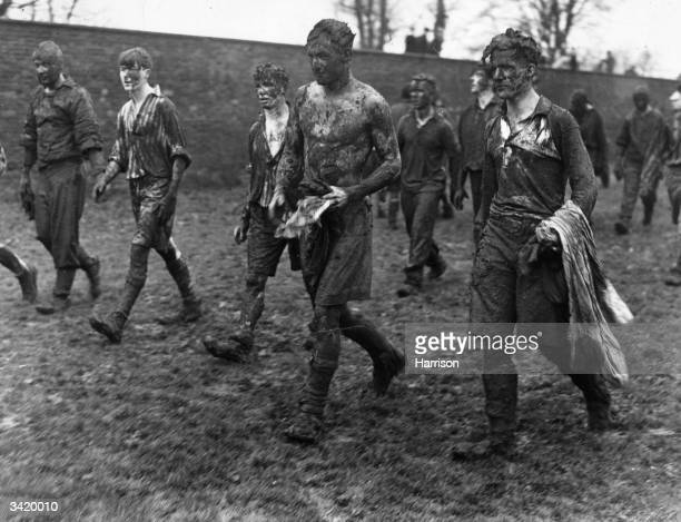 Mud covered pupils at Eton School after the annual 'Wall Game' that occurs every St Andrew's Day The game a rough muddy and chaotic spectacle...