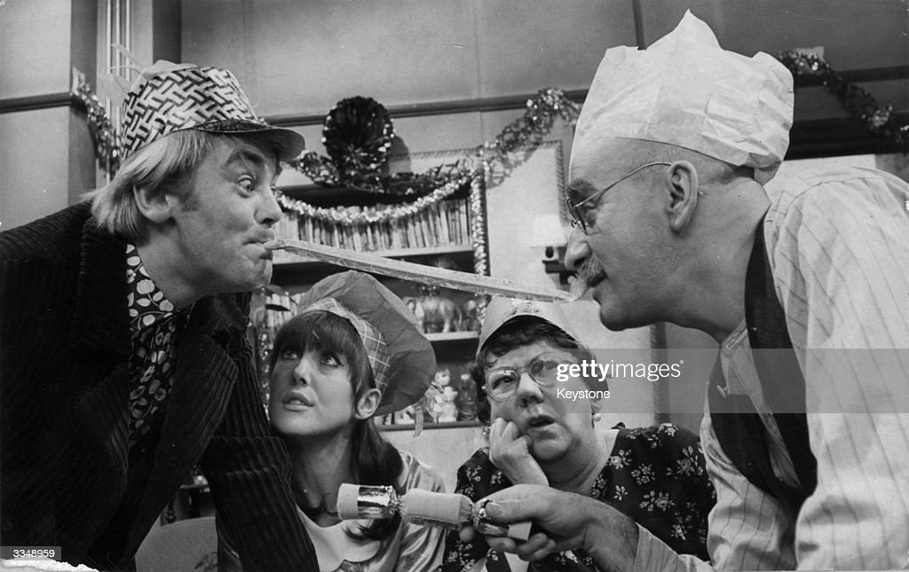 Alf Garnett played by Warren Mitchell and his soninlaw Mike played by Anthony Booth arguing over the Christmas dinner table in a scene from the...