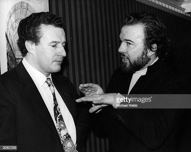 Sir Colin Rex Davis English conductor of the BBC Symphony Orchestra and Director at Covent Garden London talking to Peter Hall producer at Covent...