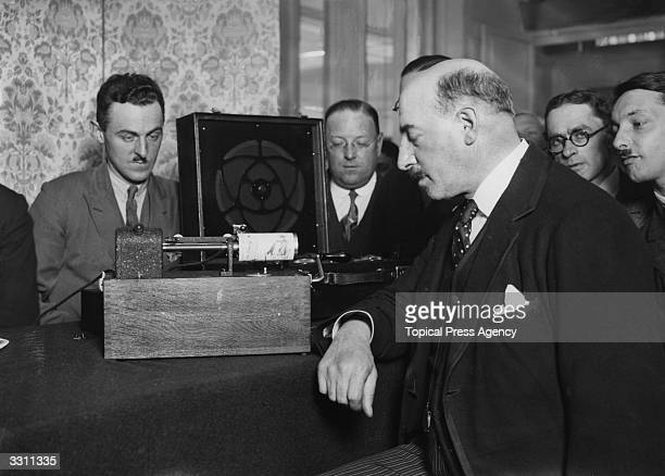 Professor Fulton receiving a picture by wireless at the Savoy Hotel London which was broadcast from the BBC headquarters
