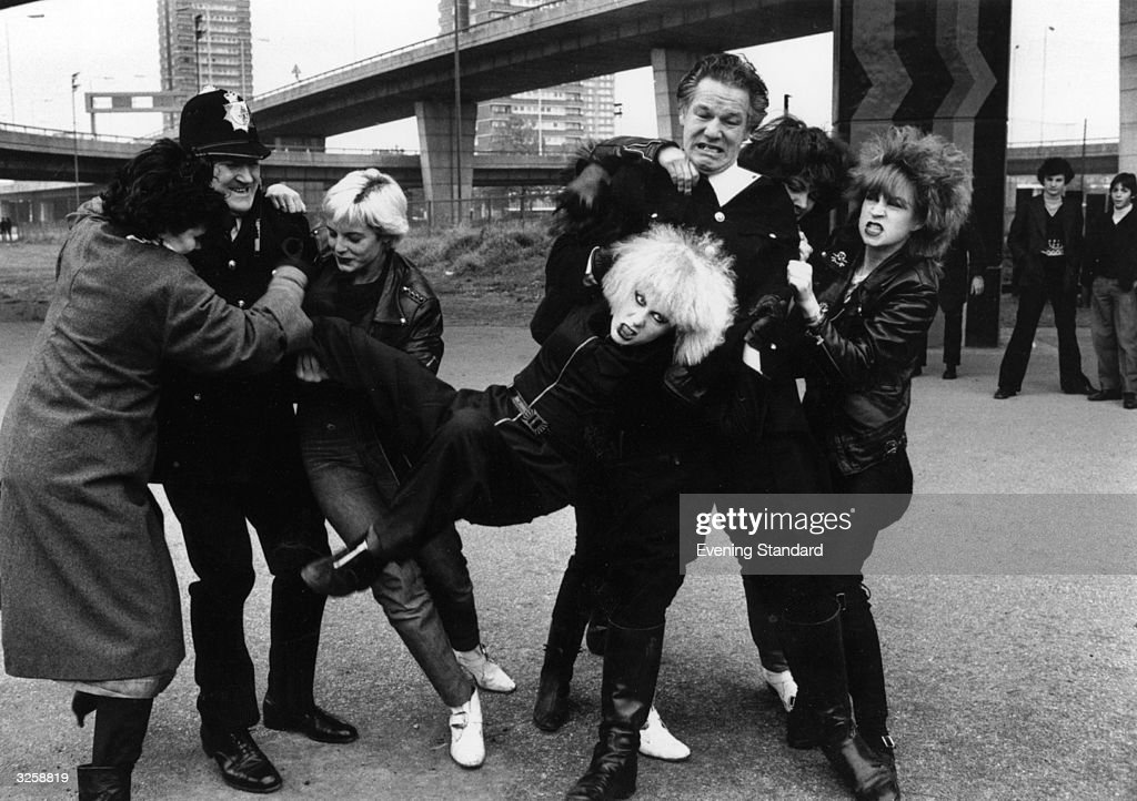 Hazel O'Connor (supported centre), British new wave pop singer, in a scene from the cult punk film 'Breaking Glass', directed by Brian Gibson.