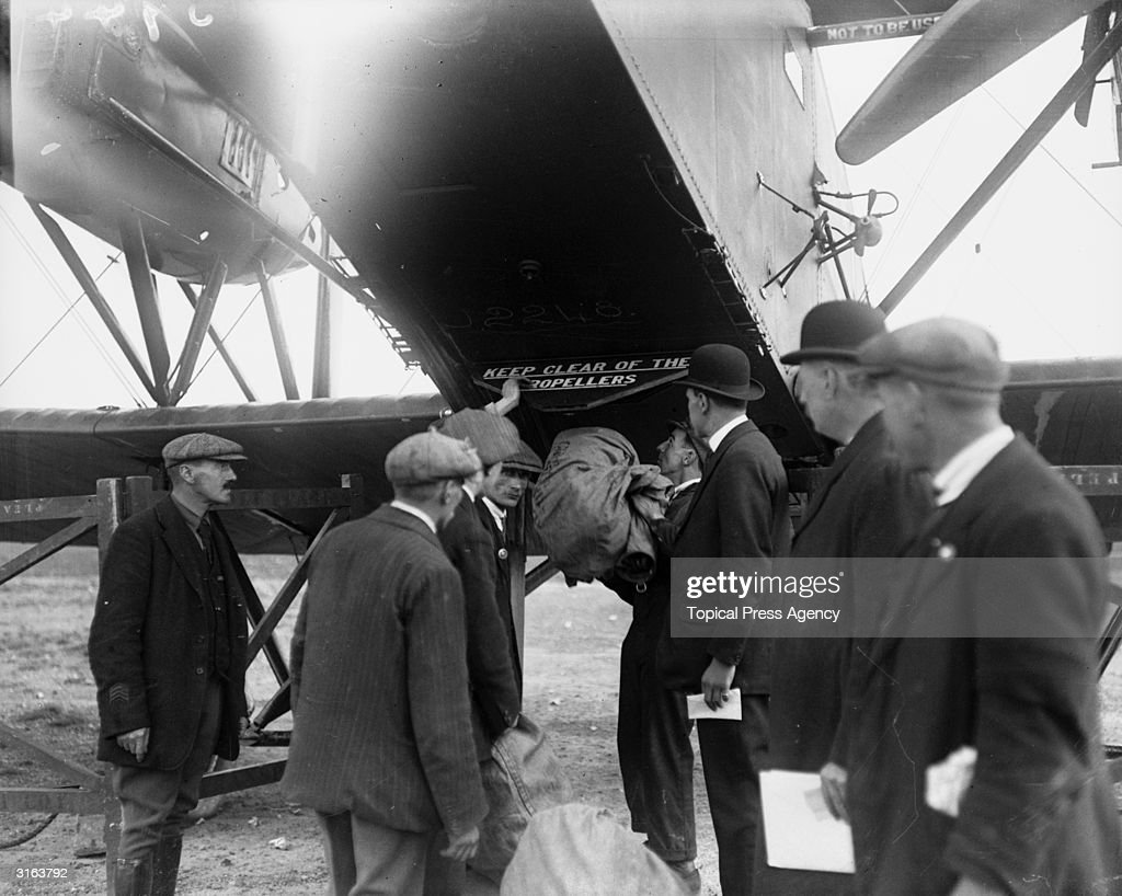 A Handley Page aeroplane is commissioned to carry mail during the railway strike.